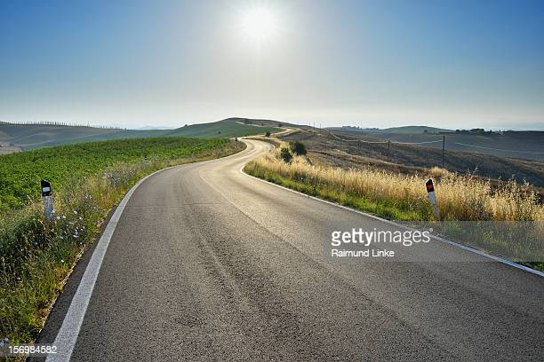 country road - curve stock pictures, royalty-free photos & images