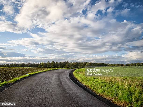 country road - belgium stock pictures, royalty-free photos & images