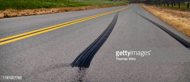 country road through rolling hills - traffic accident stock pictures, royalty-free photos & images
