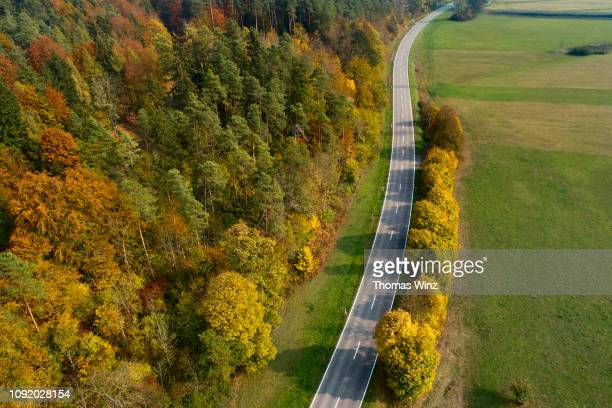 country road with fall foliage from above - baden württemberg stock pictures, royalty-free photos & images