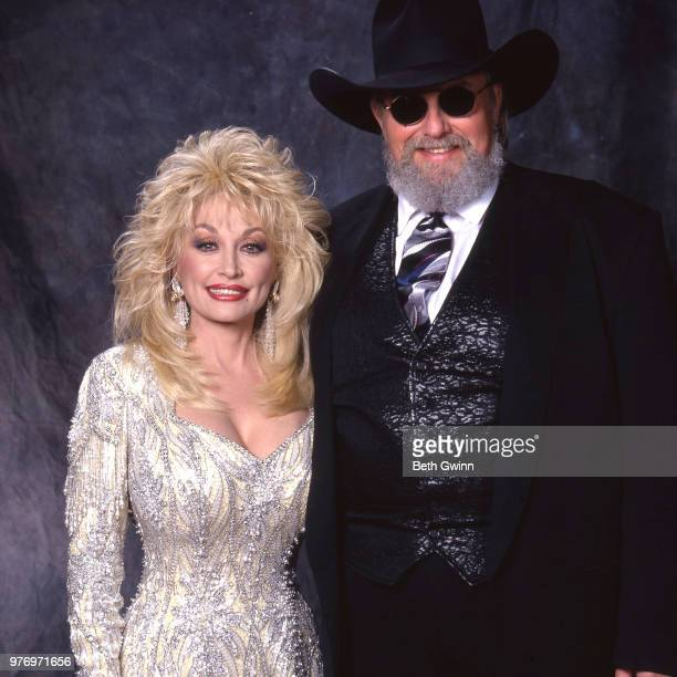 Country singer and songwriter Dolly Parton and Charlie Daniels backstage before the CMA Award Show Backstage October 10 1988 in Nashville Tennessee