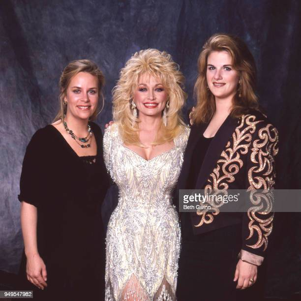 Country singer and songwriter Dolly Partonposes with Mary Chapin Carpenter and Tricia Yearwood backstage the CMA Award Show Backstage October 10 1988...