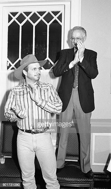 Country singer and songwriter Garth Brooks with Capitol Records executive Jim Foglesong on November 27 1989 in Nashville Tennessee