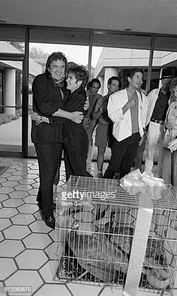 Country singer and songwriter Johnny Cash and his daughter Rosanne Cash with Rodney Crowell celebrating Rosanne Cash's first song at BMI on September...