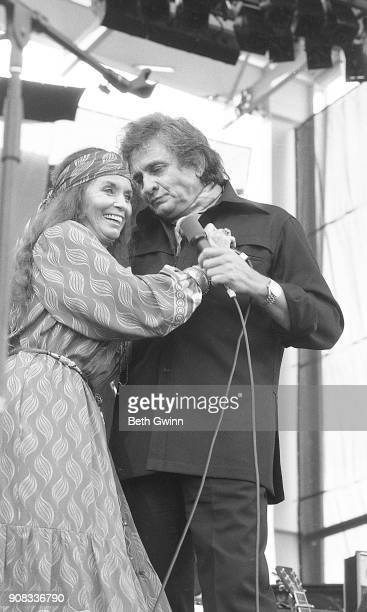 Country singer and songwriter June Carter Cash and Johnny Cash perform on July 4, 1985 in Nashville, Tennessee.