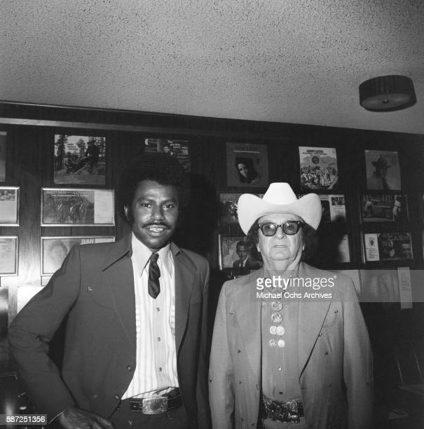 Country singer and songwriter O B McClinton and designer Nudie Cohn pose for a photo at a press party at The Palomino Club on March 20 1972 in the...