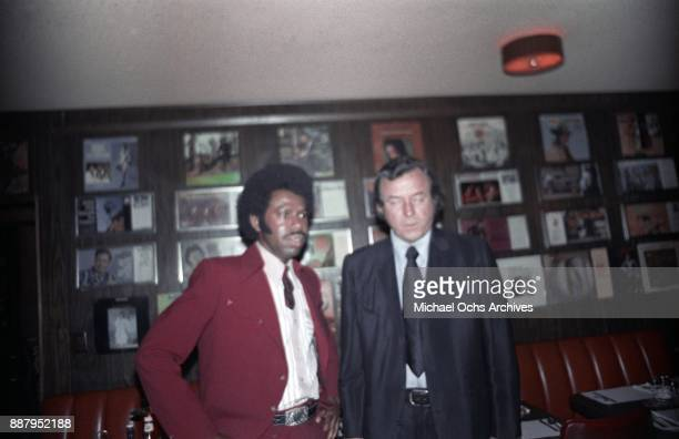Country singer and songwriter O B McClinton and Palomino owner Tommy Thomas pose for a photo at a press party at The Palomino Club on March 20 1972...