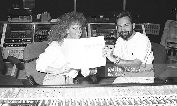 Country singer and songwriter Reba McEntire and Tony Brown in the studio on August 8 1991 in Nashville Tennessee