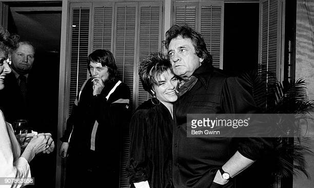 Country singer and songwriter Rosanne Cash and Johnny Cash celebrate Rosanne Cash's first song at BMI on September 6 1985 in Nashville Tennessee