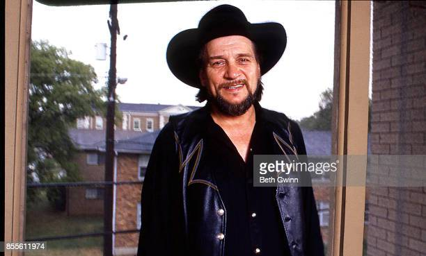 Country singer and songwriter Waylon Jennings in his office on August 271987 Nashville Tennessee
