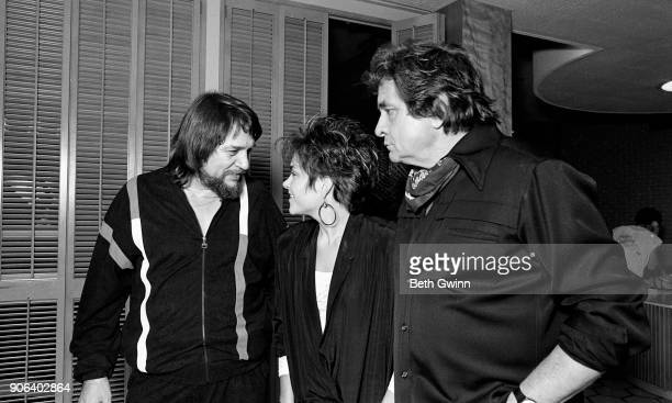 Country singer and songwriter Waylon Jennings with Rosanne Cash and Johnny Cash celebrating Rosanne Cash's first song at BMI in Nashville Tennessee