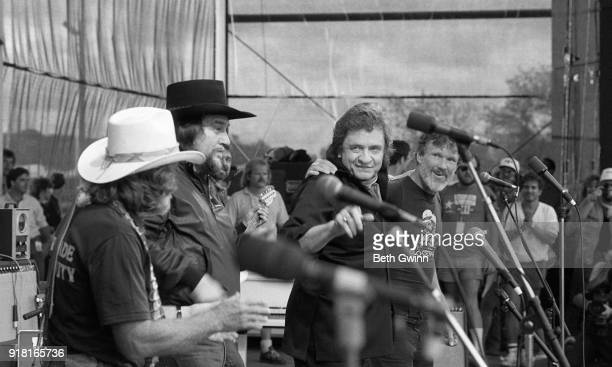 Country singer and songwriter Willie Nelson Waylon Jennings Johnny Cash and Kris Kristofferson perform as the Highwaymen at Willie Nelson Fourth of...