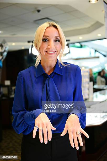 Country singer Ashley Monroe tries on The Exclusive Platinum Love Bridal Jewelry Collection by Platinum Guild International USA at Littman Jewelers...