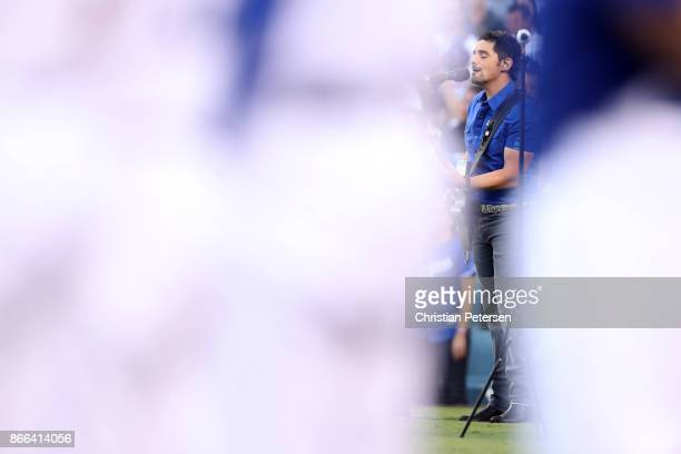 Country singer Brad Paisley performs the national anthem before game two of the 2017 World Series between the Houston Astros and the Los Angeles...