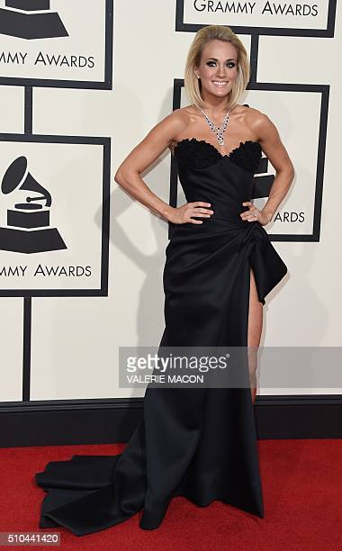 Country singer Carrie Underwood arrives on the red carpet for the 58th Annual Grammy music Awards in Los Angeles February 15 2016 AFP PHOTO/ VALERIE...