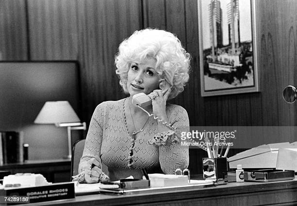 """Country singer Dolly Parton acts in a scene from the movie """"9 to 5"""" which was released on December 19, 1980."""
