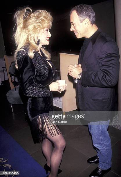 Country Singer Dolly Parton and Producer David Geffen attend the 'Shining Through' New York City Premiere on January 27 1992 at Ziegfeld Theater in...