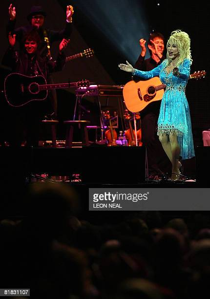 US Country singer Dolly Parton performs onstage at the o2 arena in London as part of her Backwoods Barbie world tour on July 5 2008 The tour will see...