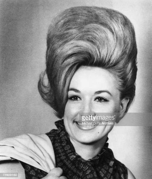 Country singer Dolly Parton poses for a portrait in 1965 in Nashville Tennessee