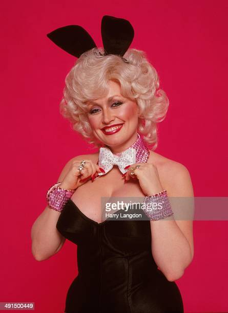 Country singer Dolly Parton poses for a portrait session dressed as a playboy bunny, 1978 in Los Angeles, California.