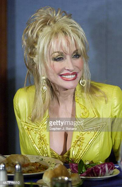 Country singer Dolly Parton speaks during a luncheon address at the National Press Club in Washington DC where she discussed 'Imagination Library'...