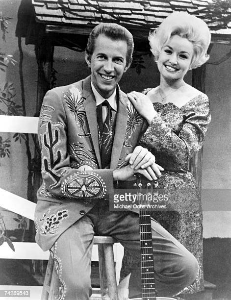 Country singer Dolly Parton with her collaborator Porter Wagoner on the set of his TV show in circa 1967 Mr Wagoner is wearing a Nudie Suit designed...