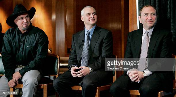 Country singer Garth Brooks NHL Players Association Executive Director Ted Saskin and NHL Commissioner Gary Bettman listen to a speaker during a news...