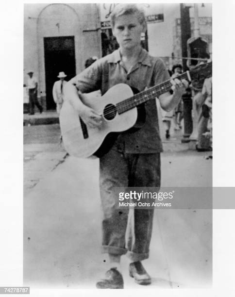 Country singer George Jones busking on the streets as a child with a guitar in circa 1940 in Beaumont Texas