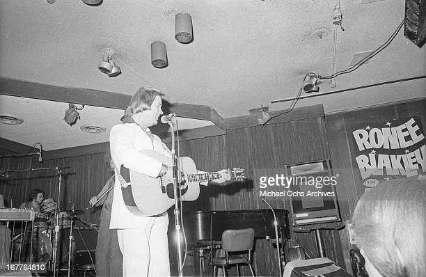 Country singer George Jones performs onstage at the Palomino Club next to a sign that reads Ronee Blakley at the Palomino Club on April 26 1978 in...