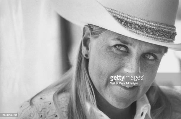 Country singer Jett Williams illegitimate daughter of late singer Hank Williams Sr wearing white cowboy hat shirt at home