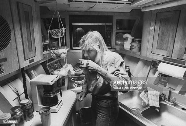 Country singer Jett Williams illegitimate daughter of late singer Hank Williams Sr drinking a cup of coffee in front of Norelco automatic coffee...