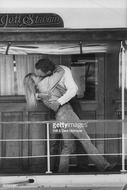 Country singer Jett Williams illegitimate daughter of late singer Hank Williams Sr getting a big laidback kiss from her manager husband Keith...