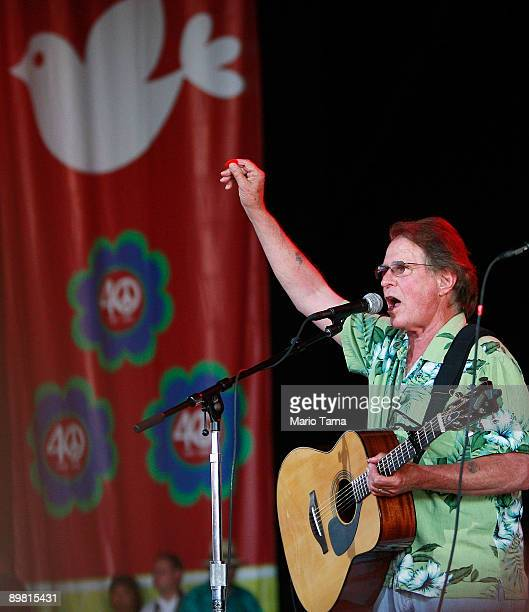 Country singer Joe McDonald sings during the concert marking the 40th anniversary of the Woodstock music festival August 15 2009 in Bethel New York...