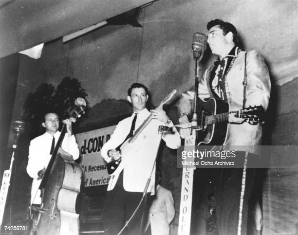 Country singer Johnny Cash performs on the WSM Grand Ole Opry tour with his band the Tennessee Two which included bassist Marshall Grant and...