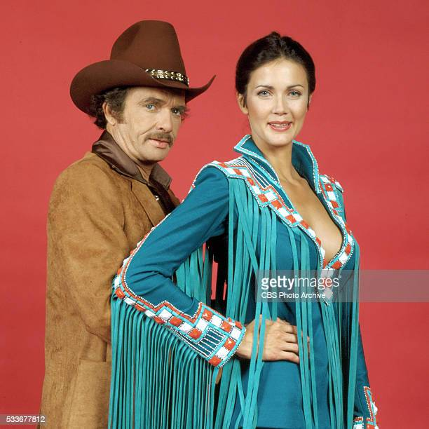Country singer Merle Haggard poses with performer Lynda Carter for the CBS Television Network program 'Lynda Carter Special' on September 16 1980