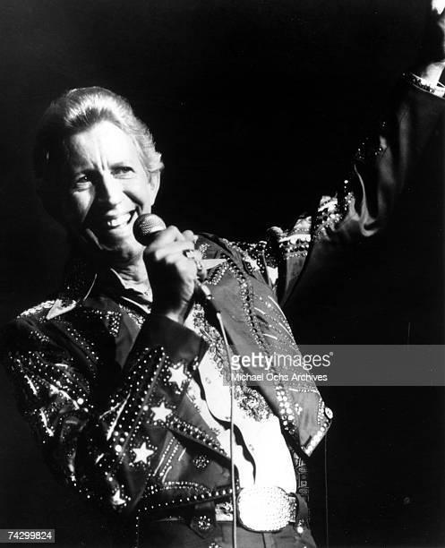 Country singer Porter Wagoner performs onstage in 1969 Mr Wagoner is wearing a Nudie Suit designed by Nudie Cohn of Nudie's Rodeo Tailors