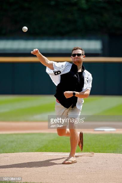 Country singer Scotty McCreery throws out a ceremonial first pitch before the game between the Chicago White Sox and the Minnesota Twins at...