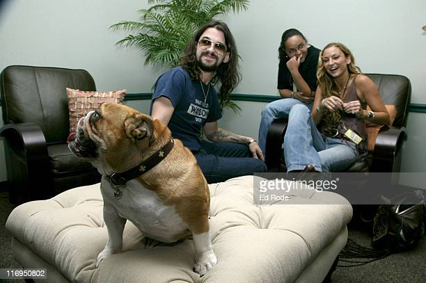 Country singer Shooter Jennings assistant Ginger Gonzales and actress Drea De Matteo relax backstage with bulldog Charly Rose at CMT's 100 GREATEST...