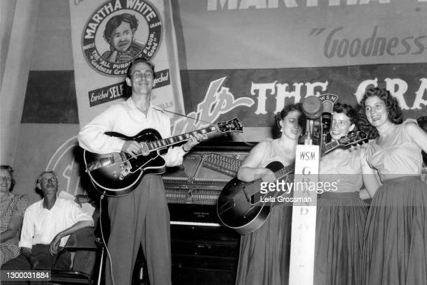 Country singer songwriter Chet Atkins performs with the Carter Family on stage at the Grand Ole Opry 1951 in Nashville, Tennessee.