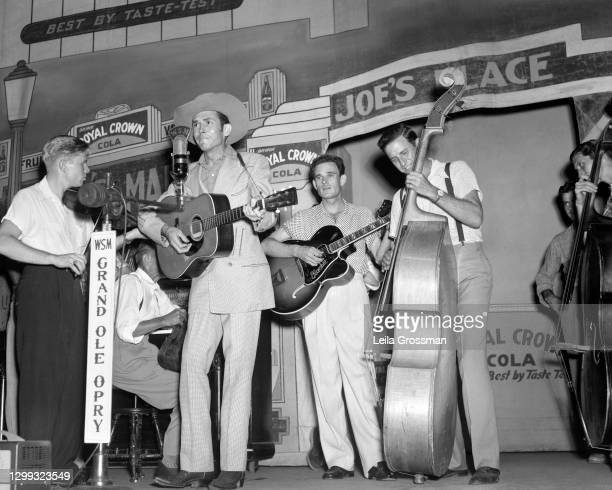 Country singer songwriter Hank Williams performs with the Drifting Cowboys on stage at the Grand Ole Opry in 1951 in Nashville, Tennessee.