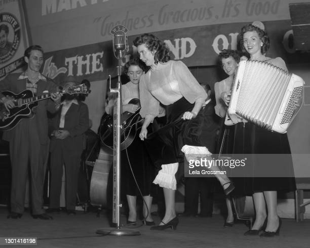 Country singer songwriter June Carter Cash flatfooting on stage with The Carter Family as well as Chet Atkins at the Grand Ole Opry in 1951 in...