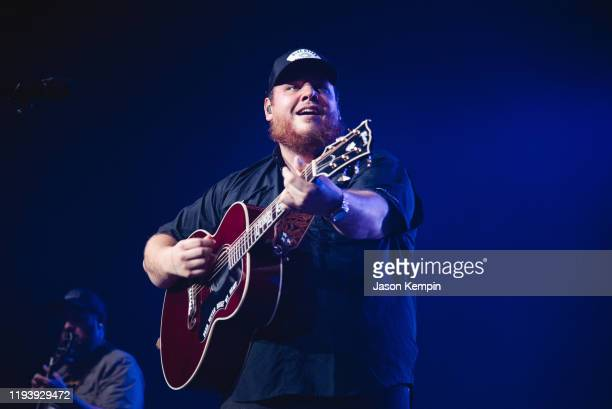 Country singer songwriter Luke Combs performs to a sold out audience at Bridgestone Arena on December 13 2019 in Nashville Tennessee