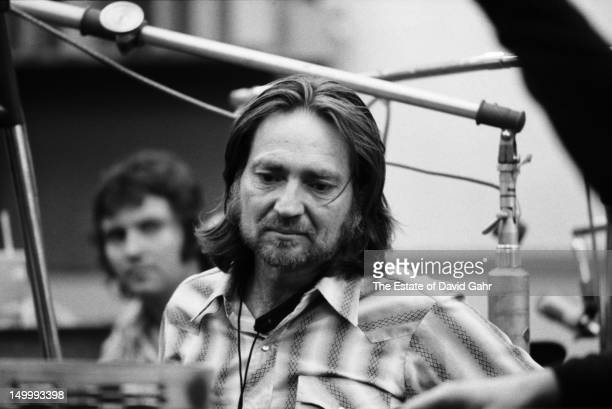 Country singer songwriter Willie Nelson and country singer Larry Gatlin in a recording session for Willie Nelson in February 1973 at the Atlantic...