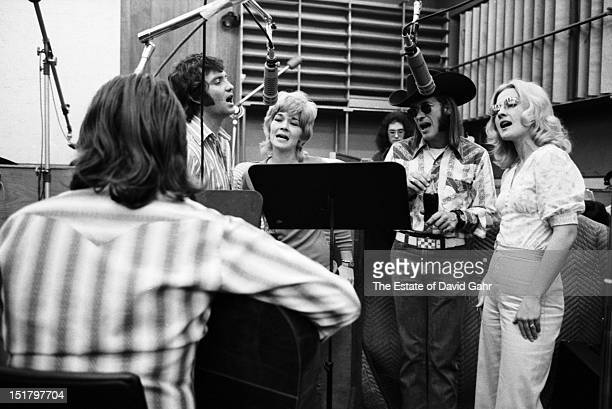 Country singer songwriter Willie Nelson in a recording session with backing vocalists Larry Gatlin, Sammi Smith, Doug Sahm, and Dee Moeller in...
