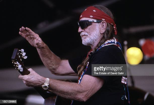 Country singer songwriter Willie Nelson performs at the New Orleans Jazz and Heritage Festival in April 1994 in New Orleans Louisiana