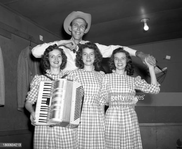 Country singer songwriters the Carter Sisters pose for a portrait backstage at the Grand Ole Opry in 1951 in Nashville, Tennessee.