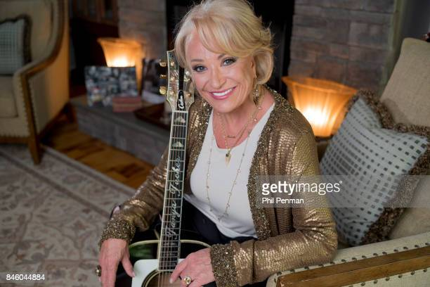 Country singer Tanya Tucker is photographed for Closer Weekly Magazine on July 18 2017 at home in Tennessee Tucker holds one of two guitars that her...
