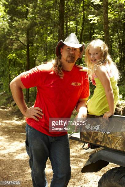 Country singer Trace Adkins and daughter Trinity pose at a portrait session for People Country on July 15 2010 in Brentwood Tennessee