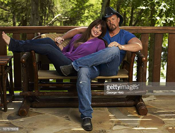 Country singer Trace Adkins and wife Rhonda pose at a portrait session for People Country on July 15 2010 in Brentwood Tennessee PUBLISHED IMAGE