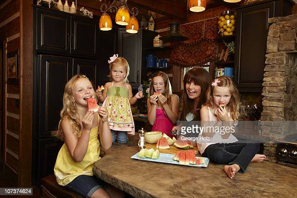 Country singer Trace Adkins' wife Rhonda with daughters Brianna Hadley Mackenzie and Trinity at a portrait session for People Country on July 15 2010...